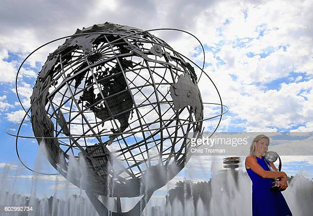 The 2016 US Open Women's Singles champion Angelique Kerber of Germany poses with her trophy in front of the Unisphere on Day Fourteen of the 2016 US...