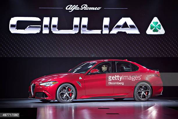 The 2017 Alfa Romeo Giulia Quadrifoglio vehicle sits on stage during the North American debut at the Los Angeles Auto Show in Los Angeles California...