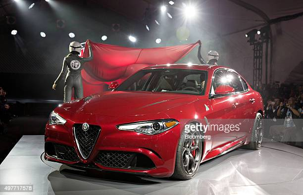 The 2017 Alfa Romeo Giulia Quadrifoglio vehicle sits on stage during its North American debut during the Los Angeles Auto Show in Los Angeles...