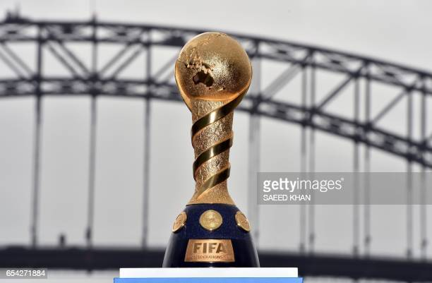 The 2017 FIFA Confederations Cup is displayed in front of the Harbour Bridge during a media call at Blues Point Reserve in Sydney on March 17 ahead...