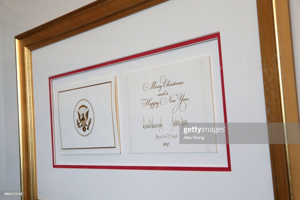 The 2017 official White House Christmas card is on display during a press preview of the 2017 holiday decorations November 27, 2017 in Washington, DC. The theme of the White House holiday decorations this year is 'Time-Honored Traditions.'