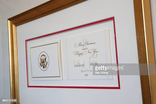 The 2017 official White House Christmas card is on display during a press preview of the 2017 holiday decorations November 27 2017 in Washington DC...