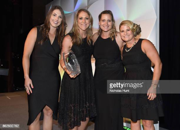 The 2017 United Sates Women's National Hockey Team receive the Wilma Rudolph Courage Award Hilary Knight Meghan Duggan presenter Angela Ruggiero and...