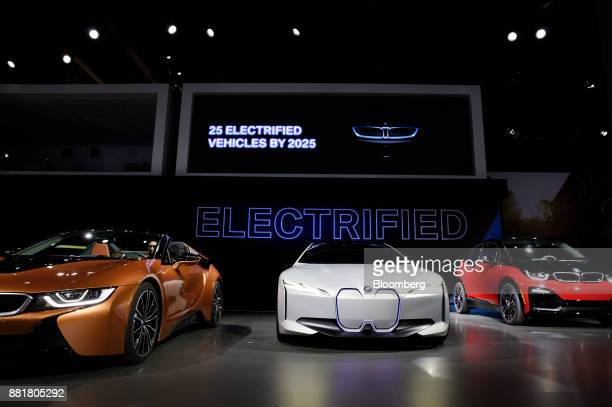 The 2018 Bayerische Motoren Werke AG i8 Roadster plugin hybrid vehicle from left i Vision Dynamics concept electric vehicle and 2018 BMW i3s electric...