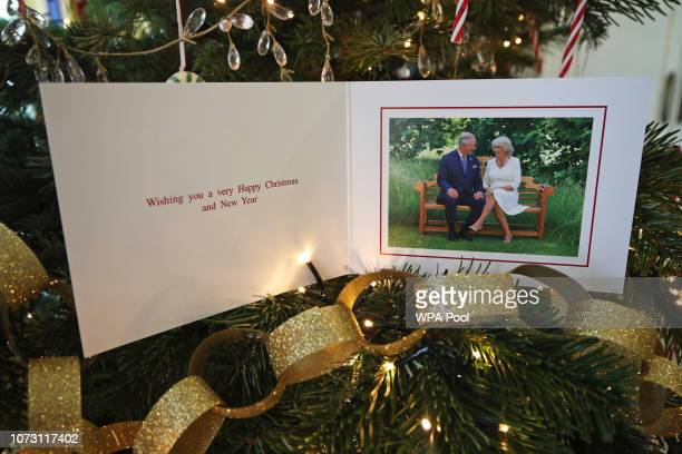 The 2018 Christmas card of the Prince of Wales and Duchess of Cornwall on a Christmas tree on December 11 2018 in Clarence House London The card...