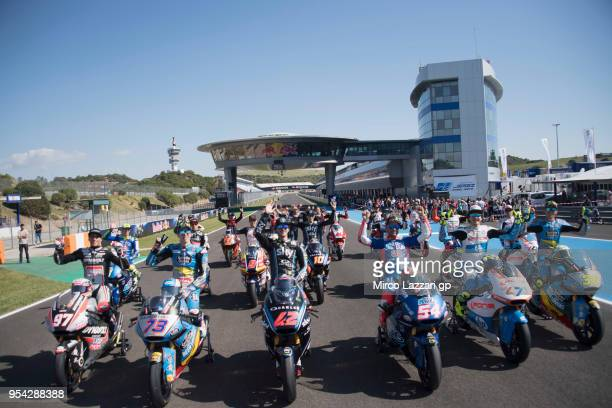 The 2018 Kalex bikes and Moto2 Riders pose on track during the MotoGp of Spain Previews at Circuito de Jerez on May 3 2018 in Jerez de la Frontera...