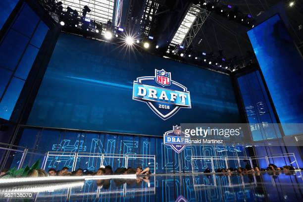 The 2018 NFL Draft logo is seen on a video board during the first round of the 2018 NFL Draft at ATT Stadium on April 26 2018 in Arlington Texas