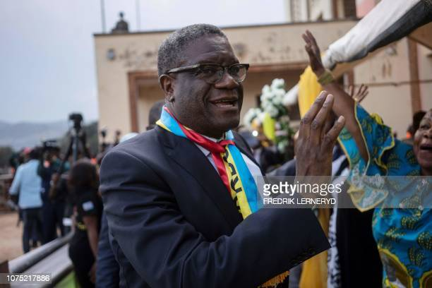 TOPSHOT The 2018 Nobel peace laureate Dr Denis Mukwege is welcomed before adressing the crowd on December 27 2018 in Bukavu as he returns in RDC for...
