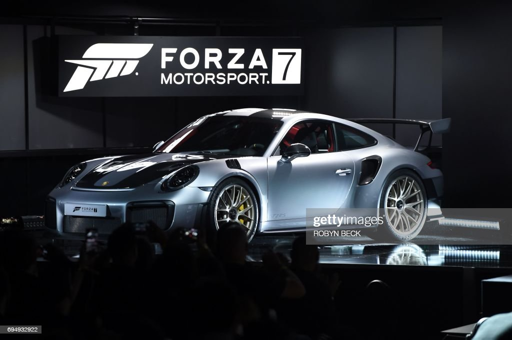 The 2018 Porsche 911 GT2 RS is introduced at the Microsoft Xbox E3 2017 Briefing, June 11, 2017 at the Galen Center in Los Angeles, California. The Electronic Entertainment Expo (E3), which focuses on new products and technologies in electronic gaming systems and interactive entertainment, takes places June 13-15 at the Los Angeles Convention Center. / AFP PHOTO / Robyn BECK