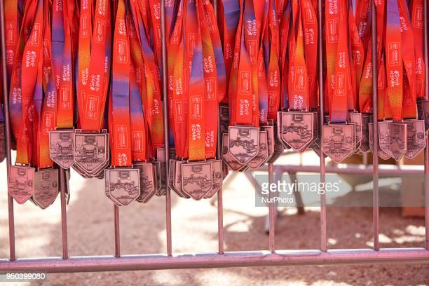 The 2018 Virgin Money London Marathon medials hanging on a rail ready to give to the altheles who have completed the London Marathon on 22 April 2018