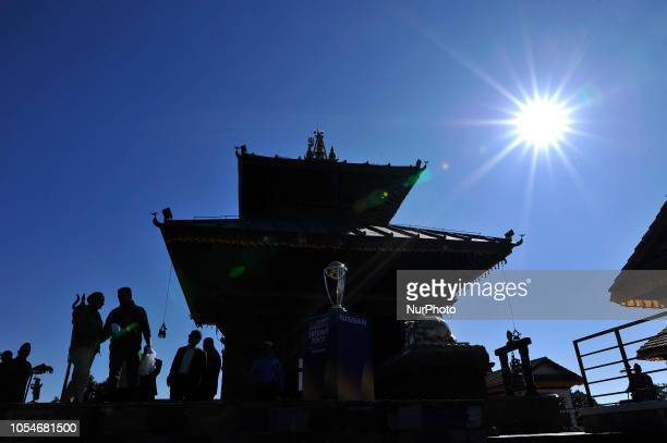 The 2019 ICC Cricket World Cup trophy is pictured infront Hindu Temple in Chandragiri Hills during a country tour in Kathmandu Nepal on Sunday...