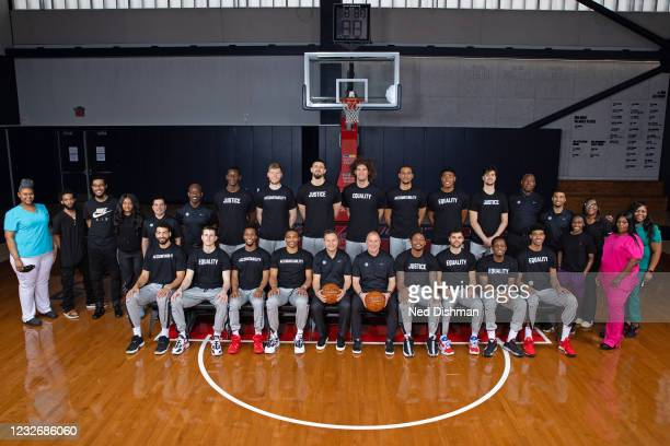 The 2020-21 Washington Wizards pose for a team photo with the personnel who tested the players daily for COVID-19 at the team facility on April 29,...