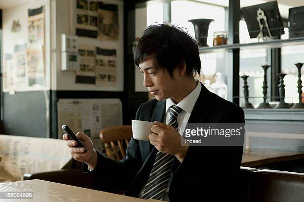 The 20th generation businessman who rests at a coffee shop