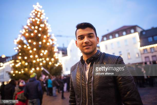 The 20yearold Afghani Ramin Amiri stands anmong hundreds of residents who have gathered to hear Richard Arnold Mayor of Schwabisch Gmuend read the...