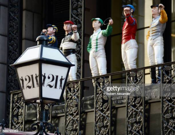 The 21 Club in Midtown Manhattan a former prohibitionera speakeasy features a colorful collection of small painted cast iron lawn jockey statues...