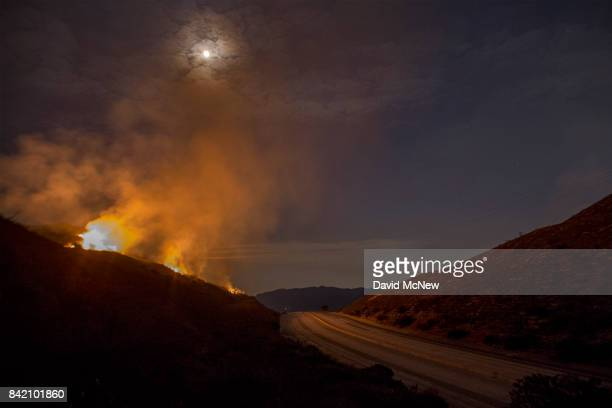 The 210 freeway remains close as flames continue to spread under moonlight at the La Tuna Fire on September 2 2017 near Burbank California Los...