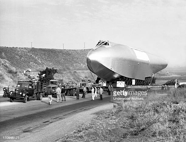 The 220 foot long hull of Howard Hughes' flying boat come to a halt on its 28 mile trip to Long Beach The towing truck broke its front axle coming up...