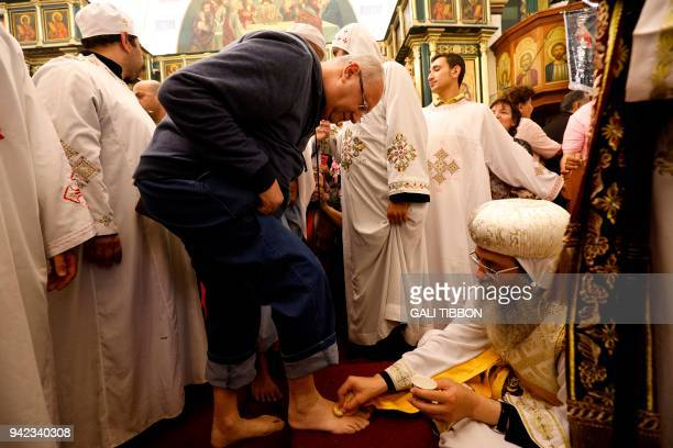 The 22nd Coptic Metropolitan of Jerusalem and the Near East Metropolitan Anba Antonious conducts the traditional Washing of the Feet ceremony at the...