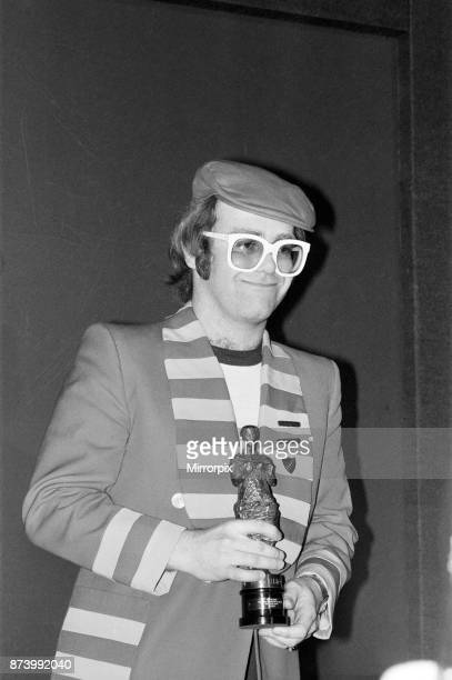 The 22nd Ivor Novello Awards presented by BASCA and sponsored by PRS Held at the Grosvenor House Hotel London Elton John pictured with his statuette...