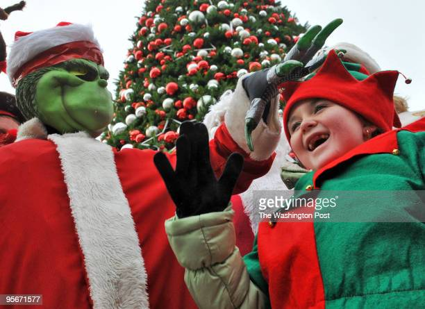 The 23rd annual 'skiing Santa' water pageant on the Potomac river Pictured the 'Grinch' gives Savanna the elf a playful pat on the head after the...