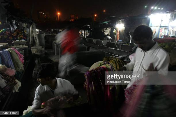 The 24 hour water cut in the city has prompted Santosh kanojia and Shankar to sort out clothes and start washing them early at the Dhobi Ghat...