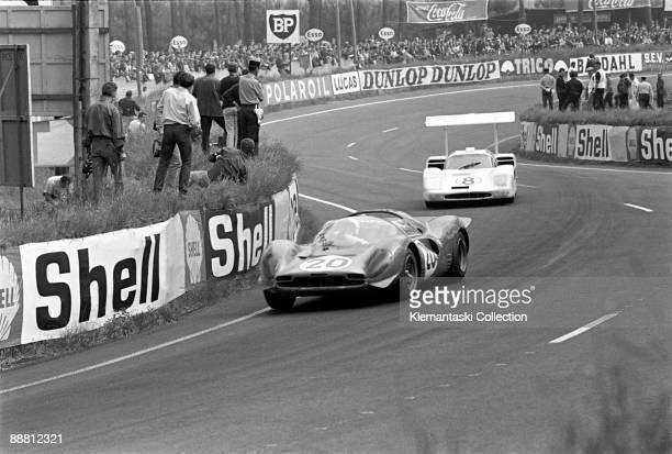 The 24 Hours of Le Mans Le Mans June 1011 1967 The Ferrari P4 driven by Chris Amon and Nino Vaccarella in the Esses ahead of the BruceJennings/Bob...