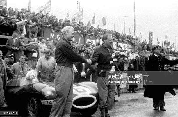 The 24 Hours of Le Mans Le Mans June 1112 1955 After the finish Hawthorn and Bueb stand in front of their Jaguar Dtype all smiles with their victory...