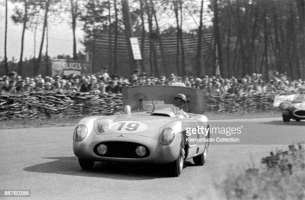 The 24 Hours of Le Mans Le Mans June 1112 1955 Juan Manuel Fangio takes his Mercedes 300SLR air brake aloft for downforce into the Esses early in the...