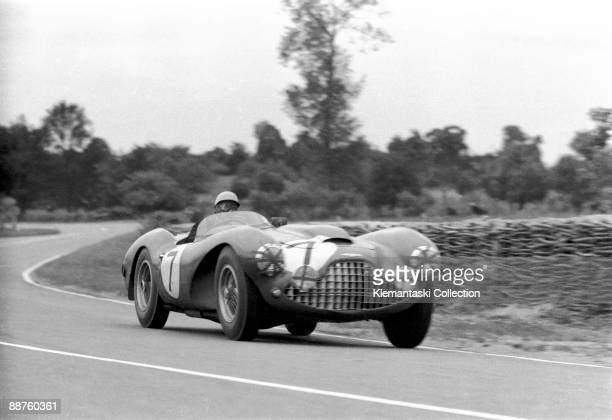 The 24 Hours of Le Mans Le Mans June 1213 1954 The Aston Martin Lagonda DP115 V12 at speed on the way toward White House Driven by Eric Thompson and...