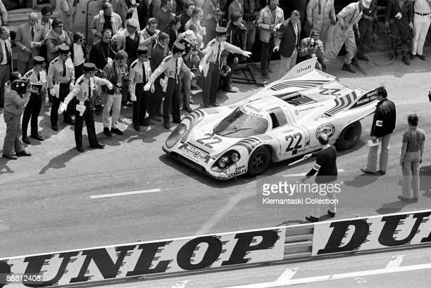The 24 Hours of Le Mans Le Mans June 12131971 The winning Porsche 917K of Helmut Marko Gijs van Lennep leaves the pits