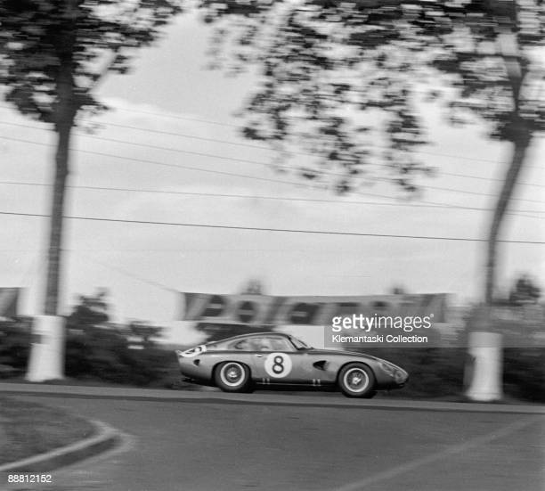 The 24 Hours of Le Mans Le Mans June 1516 1963 The Aston Martin DB4GT of Bruce McLaren and Innes Ireland on the Mulsanne