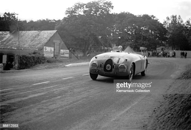 The 24 Hours of Le Mans Le Mans June 1718 1939 The winner the Bugatti Type 57SC �Tank� driven by JeanPierre Wimille and Pierre Veyron heads out of...