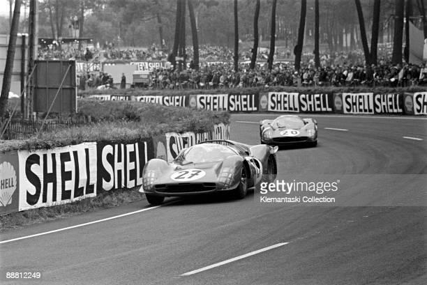 The 24 Hours of Le Mans Le Mans June 1819 1966 The Ferrari 330P3's of Scarfiotti/Parkes and Rodríguez/Ginther running through the Esses