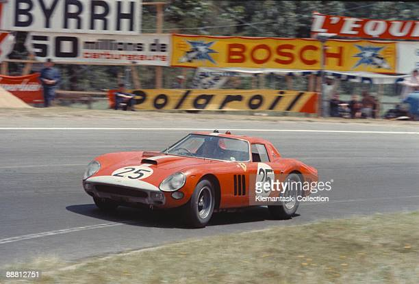 The 24 Hours of Le Mans Le Mans June 20/21 1964 N 25 is the Maranello Concessionaires Ferrari 250GTO/64 of Innes Ireland/Tony Maggs an updated...