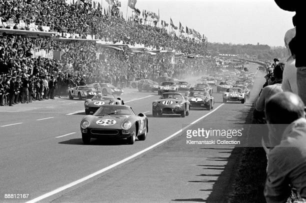 The 24 Hours of Le Mans Le Mans June 2021 1964 The start at Le Mans is like a roll of thunder Leading here is the Ferrari 250LM of David Piper and...