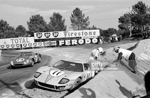 The 24 Hours of Le Mans Le Mans September 2829 1968 In the sand at Mulsanne is Brian Muir with the Ford GT40 as Mastem Gregory goes by with the...