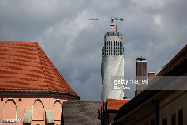 The 246 meter tall fiberglass encased Thyssenkrupp Elevator AG test tower stands beyond rooftops in Rottweill Germany on Tuesday Aug 14 2018 At the...
