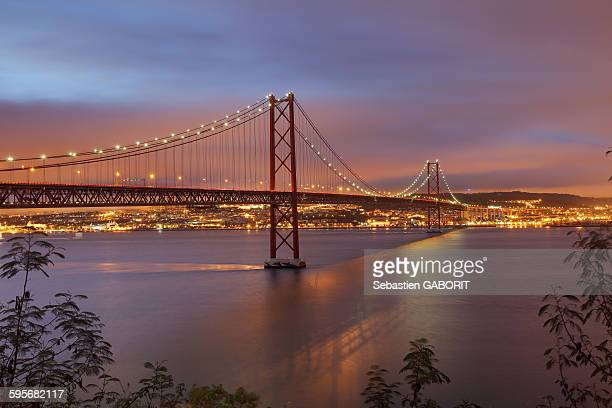 The 25 de Abril bridge at dusk