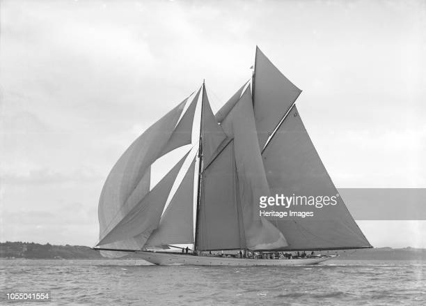 The 250 ton schooner 'Germania' sails downwind under spinnaker 1911 'Germania' was designed by Max Oertz and owned by the German industrialist Count...