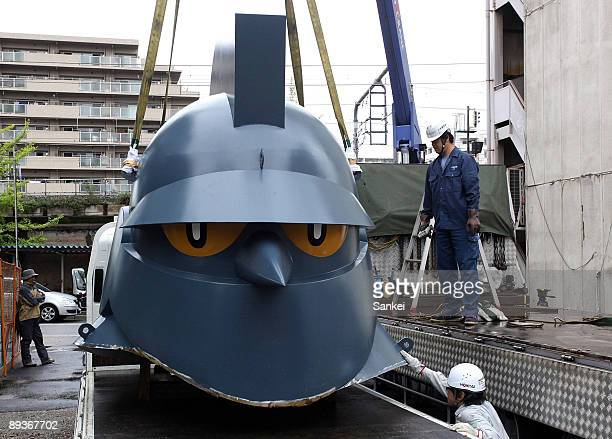 The 25meter tall head part of Tetsujin 28 Go or Gigantor arrives at Wakamatsu Park on July 27 2009 in Kobe Japan The 15meter real size statue of the...