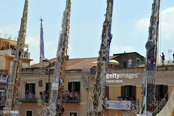 The 25metre tall 'giglio' wood and papiermache statues are displayed in the central square during the annual Festa dei Gigli 'The Lily Festival' on...