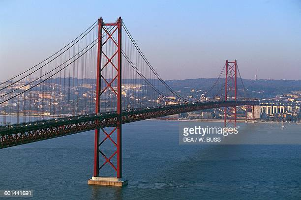 The 25th of April bridge over the Tagus river 19621966 connecting Lisbon to Almada Portugal 20th century