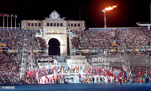 The 25th Summer Olympics Games close 09 August 1992 at Montjuic Stadium BarcelonaSpain Barcelona Mayor Pascual Maragall handed over the Olympic flag...
