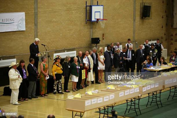 The 26 candidates int in the Haltemprice and Howden by-election line up to hear the results. David Davis won with a majority of 15,355 on July 11,...