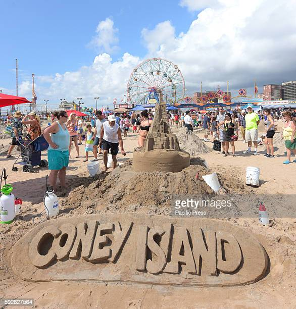 The 26th annual Coney Island sand sculpting contest took place on the beach while the first Coney Island Busker Festival played to audiences on...