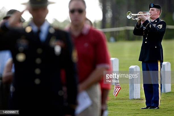 The 282nd Army Band's SSGT Bradley Hejl play Taps during the Memorial Day service Monday May 28 at Fort Jackson National Cemetery in Columbia South...
