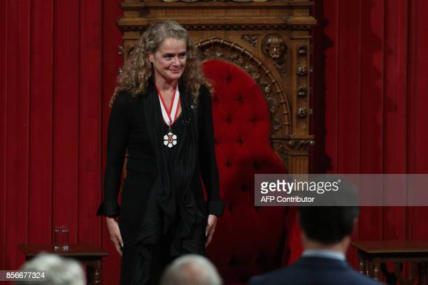 The 29th Governor general Julie Payette acknowledges the appaluse in the Senate in Ottawa, Ontario, October 2, 2017. / AFP PHOTO / Lars Hagberg