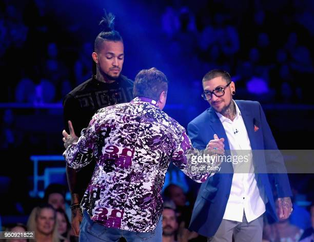 The 3 Return of the Masters finalists Anthony Michaels Steve Tefft and DJ Tambe stand onstage during the Ink Master Season 10 Finale at the Park...