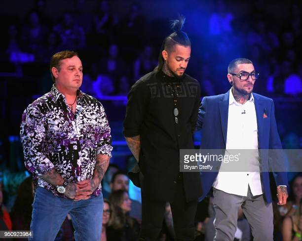 The 3 Return of the Masters finalists Steve Tefft Anthony Michaels and DJ Tambe stand onstage during the Ink Master Season 10 Finale at the Park...