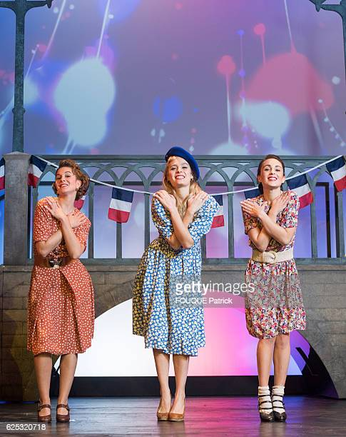 the 3 singers of the musical Un été 44 by Valery Zeitoun at the theater Comedia SarahLane Roberts Alice Raucoules and Barbara Pravi pose for Paris...